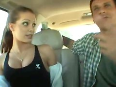 Cute sporty girl in a car sucks cock
