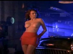 Charming hottie Wendy Hamilton poses for the cam near a car
