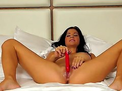 Black haired milf Lauren Crist takes her favorite red dildo and plunges it in her already wet pussy
