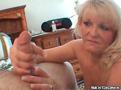 Mature blonde sucks his balls aggressively