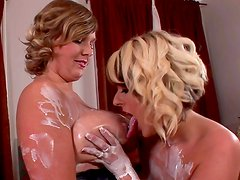 Two sexy blondes is playing with cream