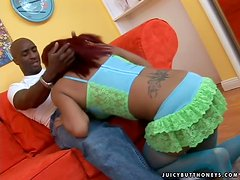 Naughty redhead ebony girl has rough sex on a sofa