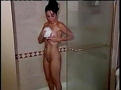 Sexy milf with great big tits takes a shower