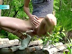 Hot beauty Yulia peeing in the pretty forest