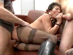 Crotchless pantyhose milf in boots fucked by two guys