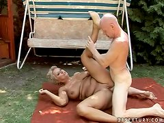 Elderly bitch Astrid gets her holes pounded in the yard