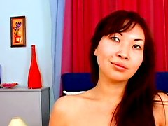 Asisha Sun is stretching her shaved pussy