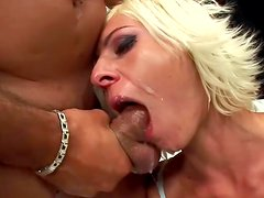 Susanna is sucking red dildo and a horny dick
