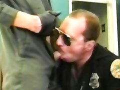 Cop sucked by man in overall