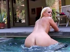 A sexy blonde hangs out in the hot tub