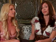Naked blonde girl talks to brunette girl sitting on the sofa