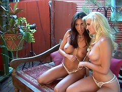 Blonde and brunette poses naked for the camera