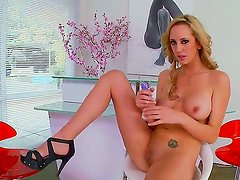Busty and naughty bitch Brett Rossi rubs her big tits and plays with her juicy pussy