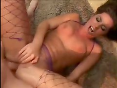Sexy fishnets and boots on horny Naomi Russell