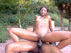 Slim oiled up black girl with great ass fucked outdoors