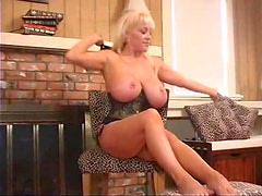Curvy blonde in corset has a good time teasing