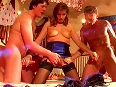 Stockings and lingerie on a girl in a threesome
