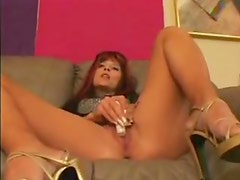 Lusty redhead teases and toys with vibrator
