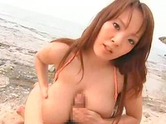 Japanese big tits hottie titjob on the beach