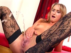 Perverted babe Tracy demonstrates her shaved snatch on the camera