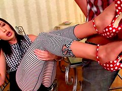 Naughty brunette gives foot job