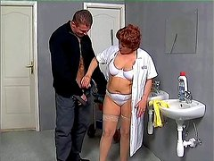 Old and fat janitor bitch Jenna gives blowjob in the public restroom