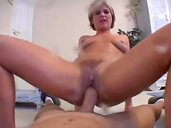 British babe spanks her pussy and takes cock