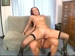 Redhead in fishnets fucked in the bum