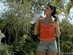 Bold brunette broad in the garden having fun with her new dildo