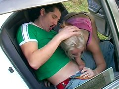 Naughty girlie gives a solid blowjob right near the car