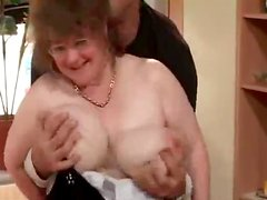 Busty granny lets the man play with her tits before he drills her cunt