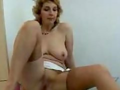 Slender mature lady loves fucking with her nylons on