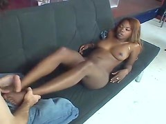 Black gal gives one hell of a footjob