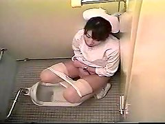 Japanese nurse plays with her pussy in a toilet. Hidden cam clip