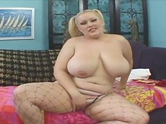 Fat white slut Bunny with huge boobs strips showing off her humps