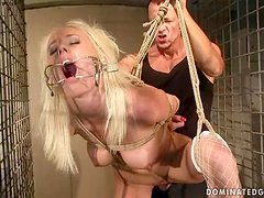 Busty Angelina Rich gets pounded and toyed in a cage