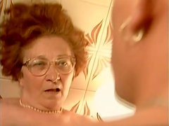 Cocksucking granny fucked in her hairy pussy