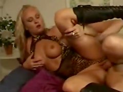 Curly hair blonde in leather boots fucked