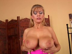 Super busty bitch Adele puts her assets together to give tits job