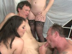 Kiki Daire is fucking in a hardcore mixed foursome sex video