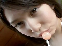 Horny student Kaori Ishii sucks a lollipop and desires to masturbate