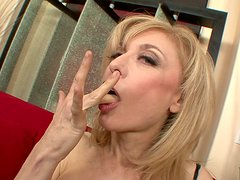 Chubby pale skin mom Nina Hartley works on young dick with her mouth