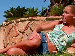 Thin and busty blondie Eliska gets topless outdoors