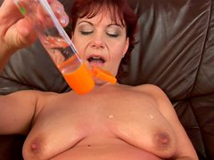 Fabulous redhead mommy Nika makes her quim soak with pussy juice