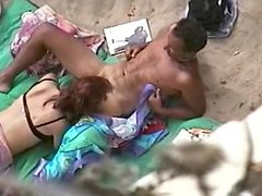 Insatiable redhead milf sucks a hard cock on a beach