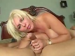 Big-breasted mature blonde takes a cock in her mouth before riding it