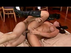 Mature in leather boots is hot as he fucks her