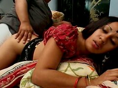 Two guys fuck Indian brunette lady Tina on the couch