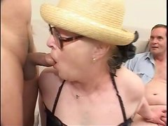 Granny in glasses does a dirty gangbang