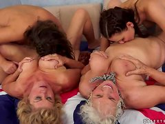 Two stunning brunette girls and two old bitches have hot sex